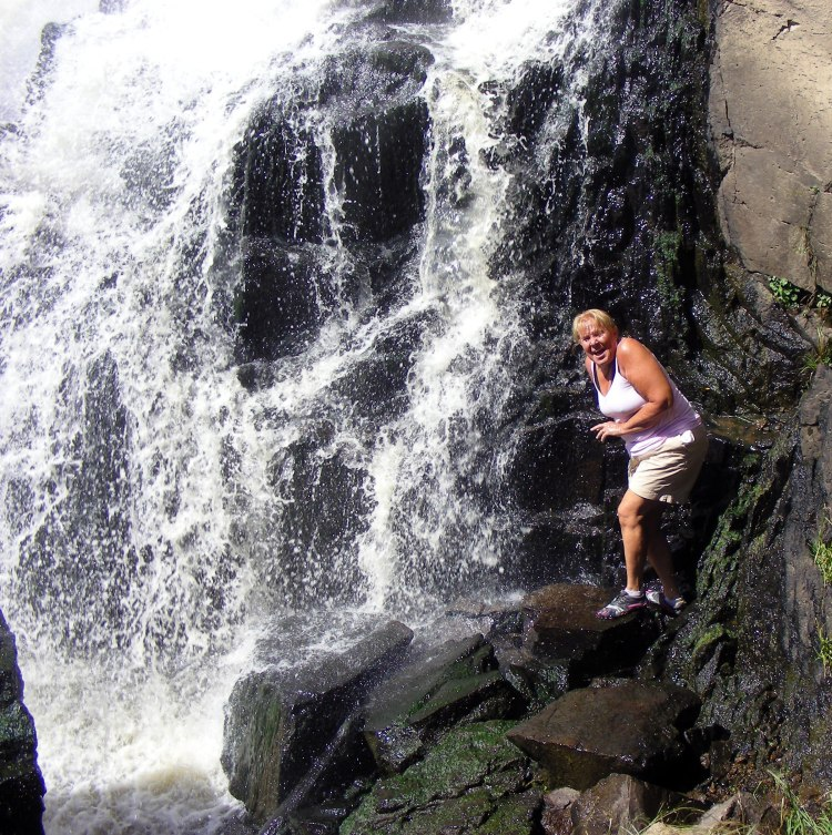Just like Norm! She climbs down and stands in the mist of this very cold water fall. No thanks. This was a great hike through thick woods via a game trail...