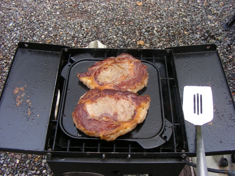 A pair of rib eyes that were cut to Norm's specs.  We eat good....