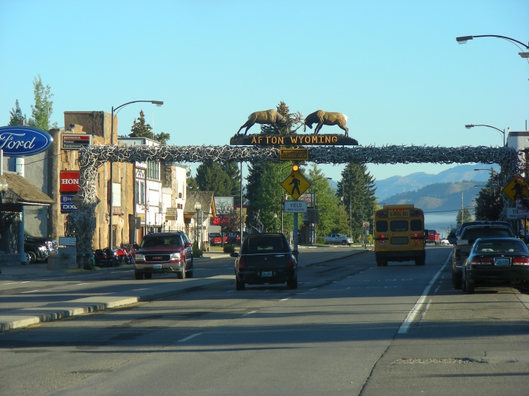 We stopped in Afton Wyoming and found a laundry to get spruced up at. This is reportedly the largest elk antler arch in the world. We couldn't argue against it. I didn't plan it, but the hearse and the bus in the same shot. The cycle of life, or close...