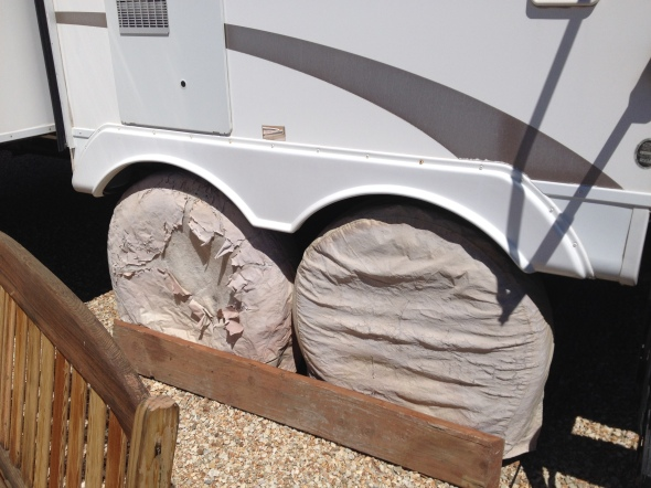 Under neath those worn wheel covers and behind the two by eight are two brand new tires (both sides), axles serviced for the tow to Oklahoma...